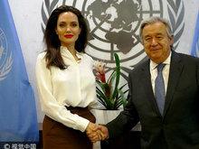 朱莉获联合国秘书长接见 白衣红唇展女王风范